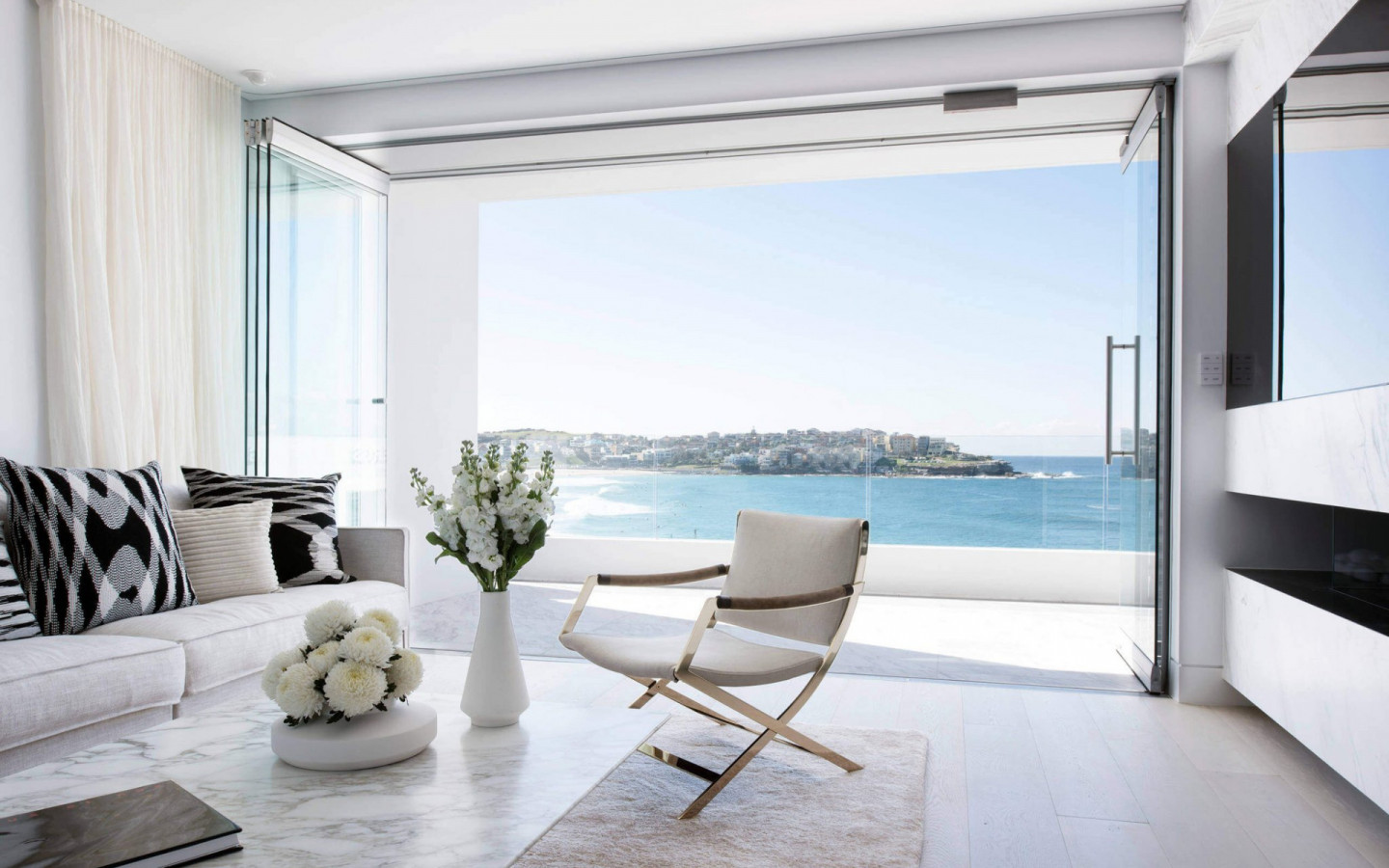 bright-apartments-modern-interior-design-minimalism-white-sofa-stylish-apartments-by-the-sea